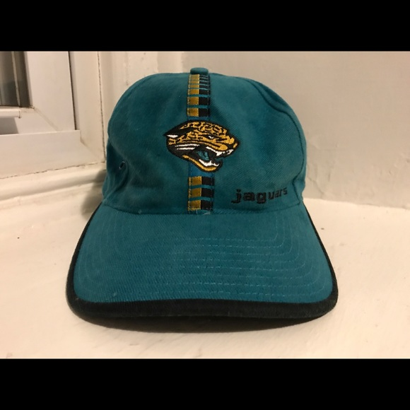 JACKSONVILLE JAGUARS NFL TURQUIOSE WINTER SANTA HAT ONE SIZE FITS ALL